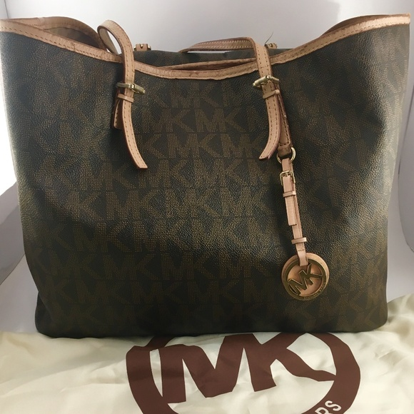 b94f1b8f7762 Michael Kors Medium Jet Set Monogram Tote Brown. M_5b6d6550e944ba52816677e4